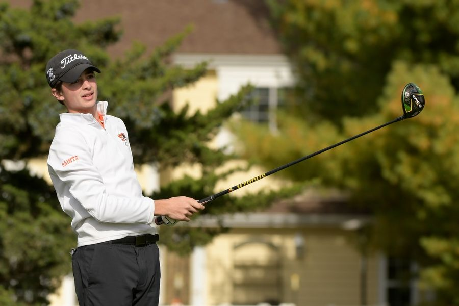 St. Charles East's Chris Petri watches his drive from the 14th tee during the Boys Golf Class 3A Oswego Sectional at Blackberry Oaks Golf Course in Bristol Oct. 13.