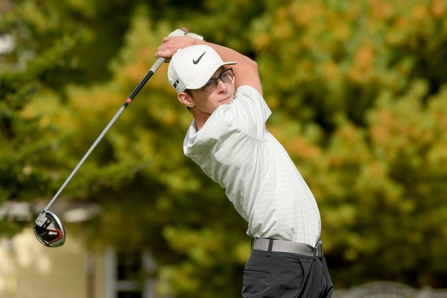 St. Charles North's Mason Siegfried watches his drive from the 14th tee during the Boys Golf Class 3A Oswego Sectional at Blackberry Oaks Golf Course in Bristol Oct. 13.
