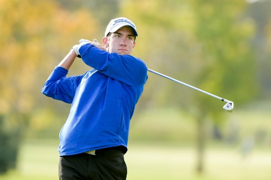 Geneva's Cal McKittrick watches his drive from the 14th tee during the Boys Golf Class 3A Oswego Sectional at Blackberry Oaks Golf Course in Bristol Oct. 13.