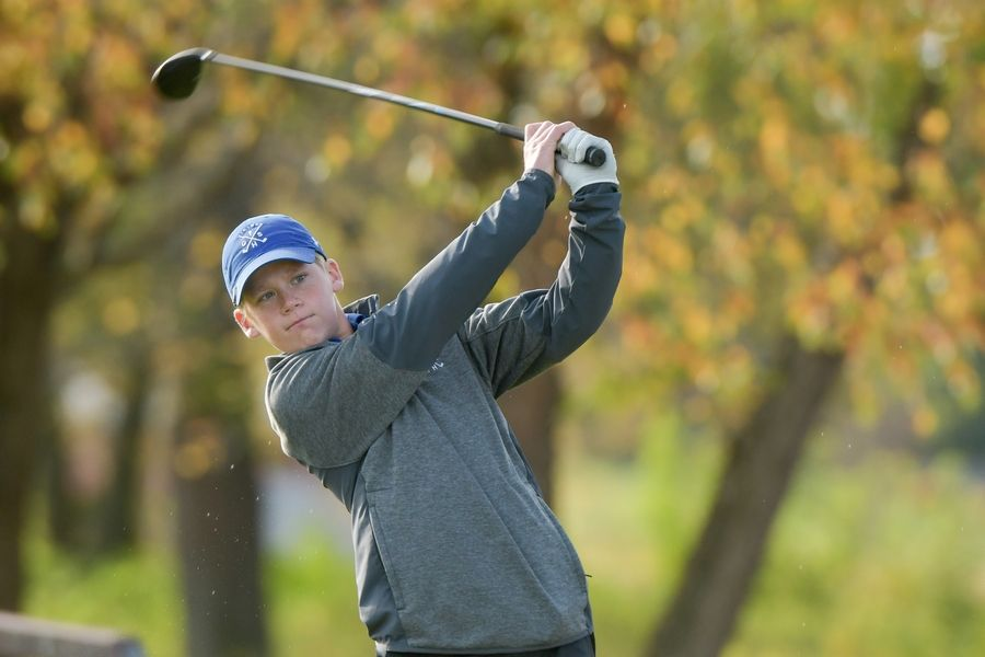 Geneva's Austin Frick watches his drive from the 14th tee during the Boys Golf Class 3A Oswego Sectional at Blackberry Oaks Golf Course in Bristol Oct. 13.