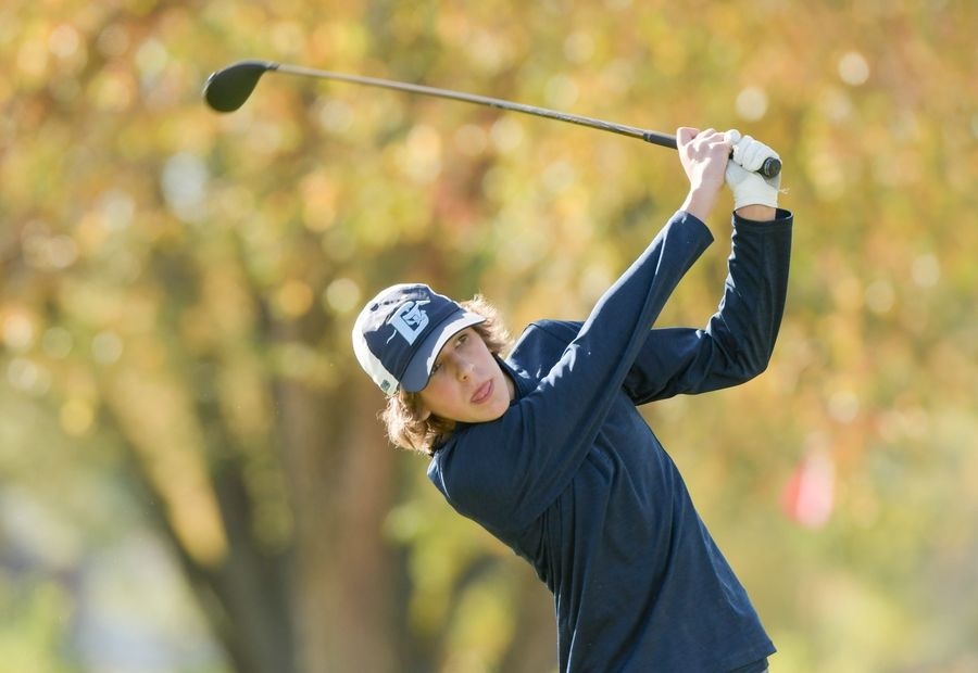 Downers Grove South's Den Orozco watches his drive from the 14th tee during the Boys Golf Class 3A Oswego Sectional at Blackberry Oaks Golf Course in Bristol Oct. 13.