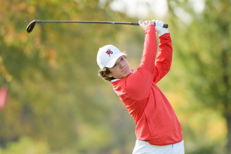 Hinsdale Central's Peter Sakkos watches his drive from the 14th tee during the Boys Golf Class 3A Oswego Sectional at Blackberry Oaks Golf Course in Bristol Oct. 13.