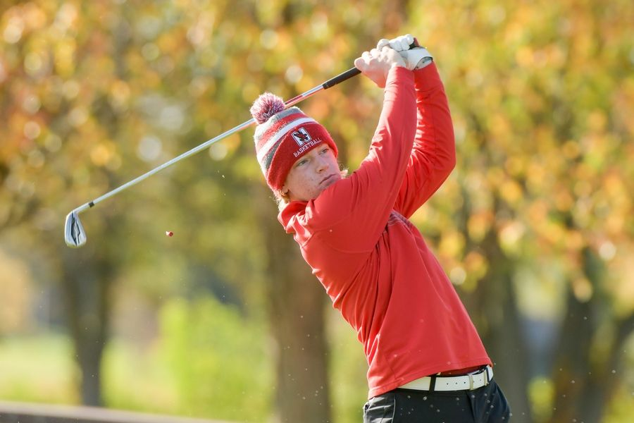 Naperville Central's Jack Busch watches his drive from the 14th tee during the Boys Golf Class 3A Oswego Sectional at Blackberry Oaks Golf Course in Bristol Oct. 13.