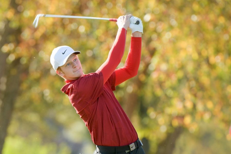 Naperville Central's Brian Izzo watches his drive from the 14th tee during the Boys Golf Class 3A Oswego Sectional at Blackberry Oaks Golf Course in Bristol Oct. 13.