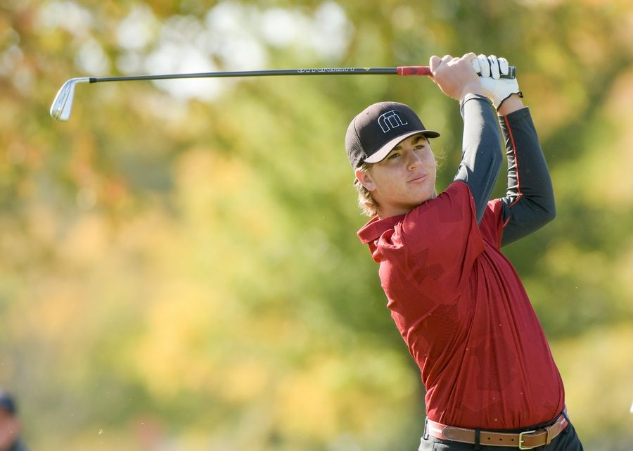 Naperville Central's Andrew Maul watches his drive from the 14th tee during the Boys Golf Class 3A Oswego Sectional at Blackberry Oaks Golf Course in Bristol Oct. 13.