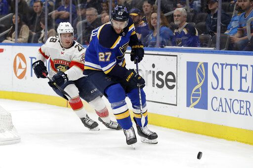 FILE - In this March 9, 2020, file photo, St. Louis Blues' Alex Pietrangelo (27) and Florida Panthers' Aleksi Saarela (28) chase after the puck during the first period of an NHL hockey game in St. Louis. The Vegas Golden Knights have agreed to terms on a $61.6 million, seven-year contract with top free agent Pietrangelo, a person with direct knowledge of the move tells The Associated Press.