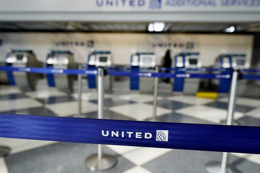Empty ticketing counters are seen in Terminal 1 at O'Hare International Airport in Chicago, Wednesday, Oct. 14, 2020. United Airlines, which furloughed 13,000 employees this month, is expected to report a large third-quarter loss as the coronavirus pandemic continues to batter air travel.