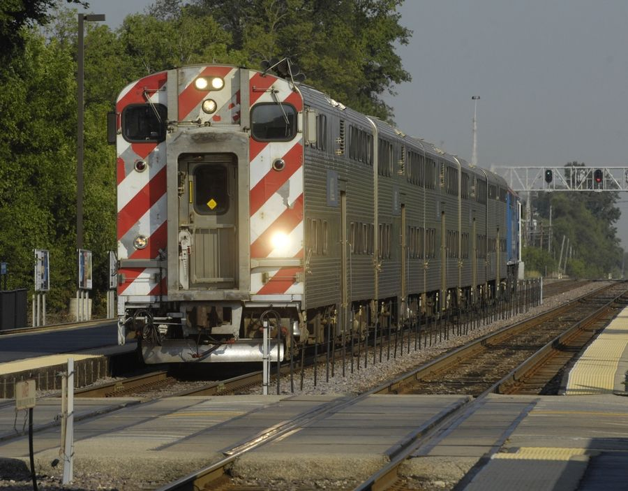 Metra is suing Union Pacific to require its conductors to collect fares and walk railcars.