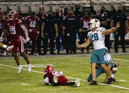 Coastal Carolina place kicker Massimo Biscardi (29) kicks the eventual game-winning field goal during the second half of an NCAA college football game against Louisiana-Lafayette in Lafayette, La., Wednesday, Oct. 14, 2020.