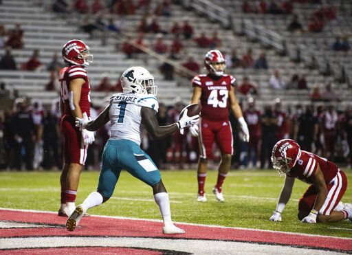 Coastal Carolina running back CJ Marable (1) searches for an official's signal after scoring a touchdown during the first half of an NCAA football game against Louisiana-Lafayette in Lafayette, La., Wednesday, Oct. 14, 2020.