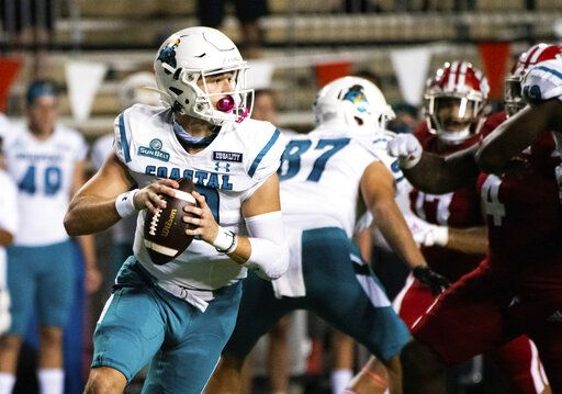 Coastal Carolina quarterback Grayson McCall (10) rolls out to attempt a pass during the first half of an NCAA football game against Louisiana-Lafayette in Lafayette, La., Wednesday, Oct. 14, 2020.