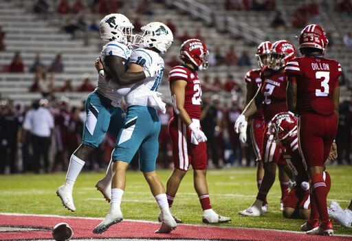 Coastal Carolina running back CJ Marable (1) and quarterback Grayson McCall (10) celebrate after Marable scored a touchdown during the first half of an NCAA football game against Louisiana-Lafayette in Lafayette, La., Wednesday, Oct. 14, 2020.