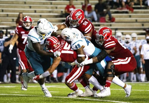 Louisiana-Lafayette running back Elijah Mitchell (15) is tackled by Coastal Carolina linebacker Enock Makonzo (43) and safety Cameron Mitchell (49) during the first half of an NCAA football game in Lafayette, La., Wednesday, Oct. 14, 2020.