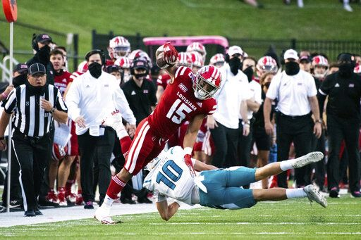 Louisiana-Lafayette running back Elijah Mitchell (15) is tackled by Coastal Carolina safety Alex Spillum (10) during the first half of an NCAA football game in Lafayette, La., Wednesday, Oct. 14, 2020.