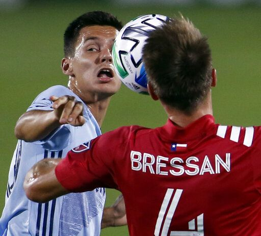 FC Dallas' Bressan (4) has a face to face meeting with Sporting KC's Daniel Salloi (20) as the two fought for ball possession at midfield during the first half of an MLS soccer game in Frisco, Texas, Wednesday, Oct. 14, 2020. (Steve Hamm/The Dallas Morning News via AP)