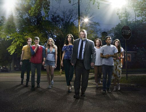 "This image released by Peacock shows, from left, Breeda Wool, Harry Treadaway, Kelly Lynch, Mary-Louise Parker, Brendan Gleeson, Holland Taylor, Jharrel Jerome and Justine Lupe from the series ""Mr. Mercedes,"" based on a Stephen King trilogy. The first two seasons of 'œMr. Mercedes'� will be bingeable on Peacock starting on Oct. 15. (Photo by: Sonar Entertainment/Peacock)"