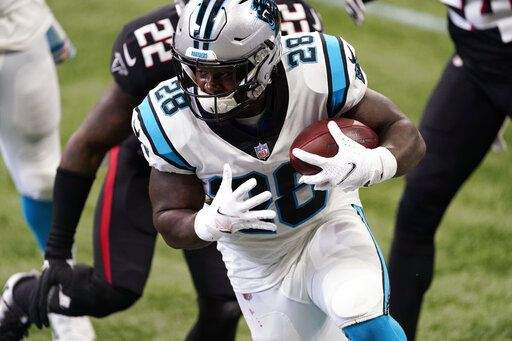 Carolina Panthers running back Mike Davis (28) runs against the Atlanta Falcons during the first half of an NFL football game, Sunday, Oct. 11, 2020, in Atlanta.