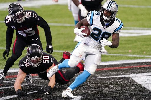 Carolina Panthers running back Mike Davis (28) runs after a ctach against the Atlanta Falcons during the first half of an NFL football game, Sunday, Oct. 11, 2020, in Atlanta.