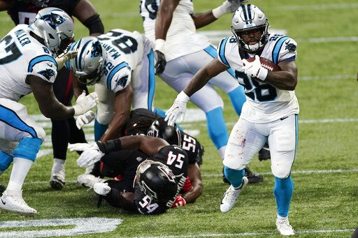 Carolina Panthers running back Mike Davis (28) runs against the Atlanta Falcons during the second half of an NFL football game, Sunday, Oct. 11, 2020, in Atlanta.