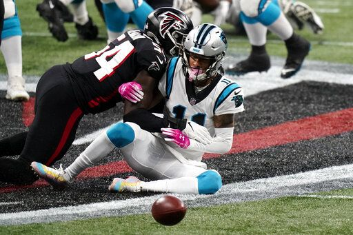 Carolina Panthers wide receiver Robby Anderson (11) misses the catch against Atlanta Falcons linebacker Foye Oluokun (54) during the first half of an NFL football game, Sunday, Oct. 11, 2020, in Atlanta.
