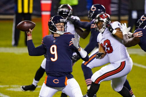 Chicago Bears quarterback Nick Foles (9) throws a pass during the first half of the team's NFL football game against the Tampa Bay Buccaneers in Chicago, Thursday, Oct. 8, 2020.
