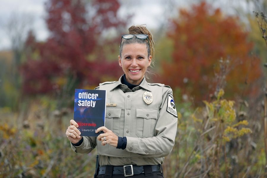 McHenry County Conservation District Police Chief Laura King recently published a book to help fellow police officers and other first responders deal with the mental stresses of the job. The book brings together King's two areas of expertise -- law enforcement and psychology.