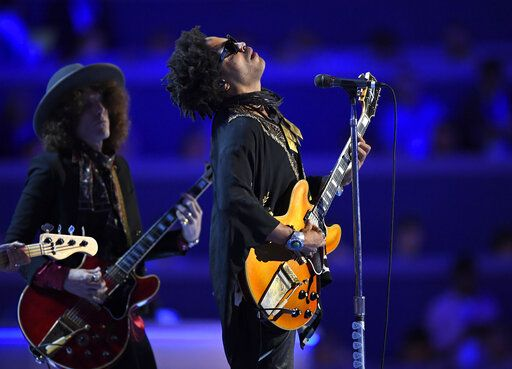 "FILE - Singer Lenny Kravitz performs during the Democratic National Convention in Philadelphia on July 27, 2016. In a new memoir, ""Let Love Rule,"" Kravitz explores his childhood and ends with him on the verge of stardom and deeply in love with actress Lisa Bonet."