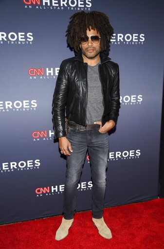 "FILE - Musician Lenny Kravitz attends the 12th annual CNN Heroes: An All-Star Tribute in New York on Dec. 9, 2018.  In a new memoir, ""Let Love Rule,"" Kravitz explores his childhood and ends with him on the verge of stardom and deeply in love with actress Lisa Bonet. (Photo by Evan Agostini/Invision/AP, File)"