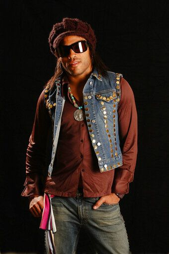 "FILE - Lenny Kravitz appears during a portrait session in New York on May 20, 2004. In a new memoir, ""Let Love Rule,"" Kravitz explores his childhood and ends with him on the verge of stardom and deeply in love with actress Lisa Bonet."