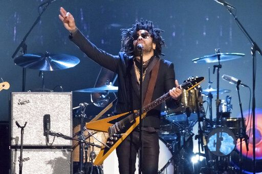 "FILE - Lenny Kravitz performs at the 2017 Rock and Roll Hall of Fame induction ceremony in New York on April 7, 2017. In a new memoir, ""Let Love Rule,"" Kravitz explores his childhood and ends with him on the verge of stardom and deeply in love with actress Lisa Bonet.  (Photo by Charles Sykes/Invision/AP, File)"