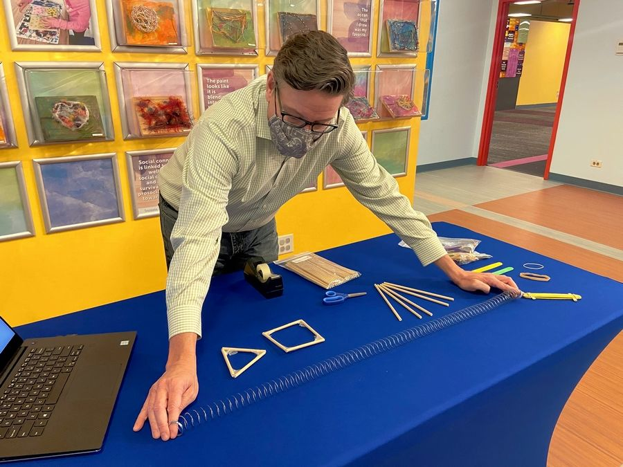 Brett Nicholas, chief of play and learning, shows off the new virtual STEM with DCM Labs offered at the DuPage Children's Museum in Naperville.