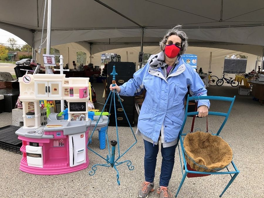 "Sue Muchowski of Gurnee found some ""garden art"" at the Society of St. Vincent de Paul tent sale Saturday in Libertyville."