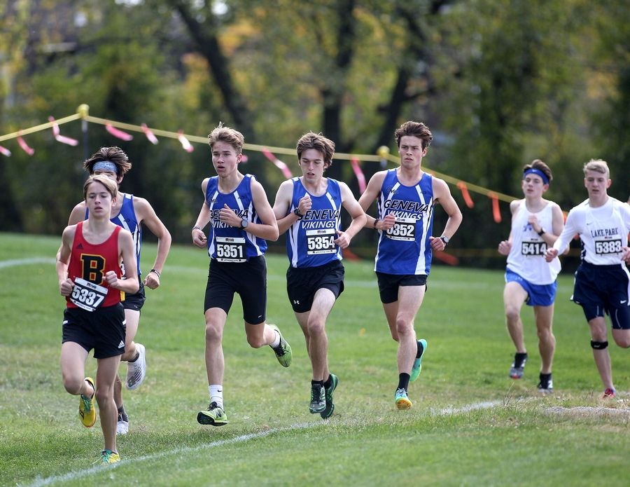 Runners compete in the first of two races during the DuKane Conference boys cross country meet at Lake Park High School's East Campus on Oct. 17.