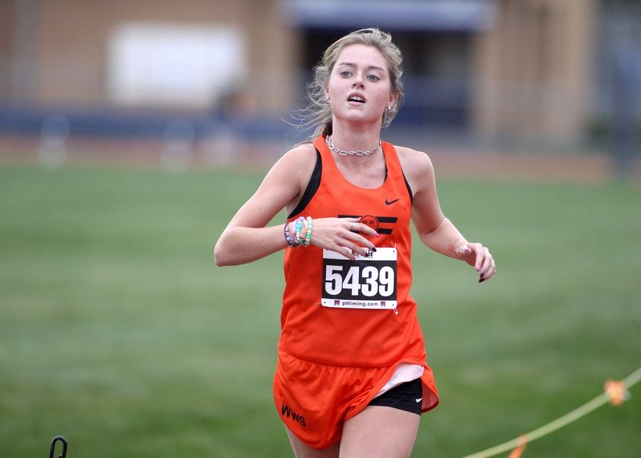 Wheaton Warrenville South's Samantha Poglitsch is the second to cross the finish in the first of two girls varsity races during the DuKane Conference cross country meet at Lake Park High School's East Campus on Oct. 17.