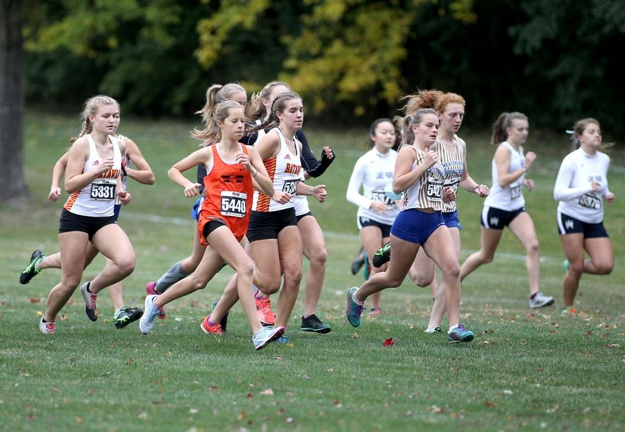 Runners compete in the second of two girls varsity races during the DuKane Conference cross country meet at Lake Park High School's East Campus on Oct. 17.