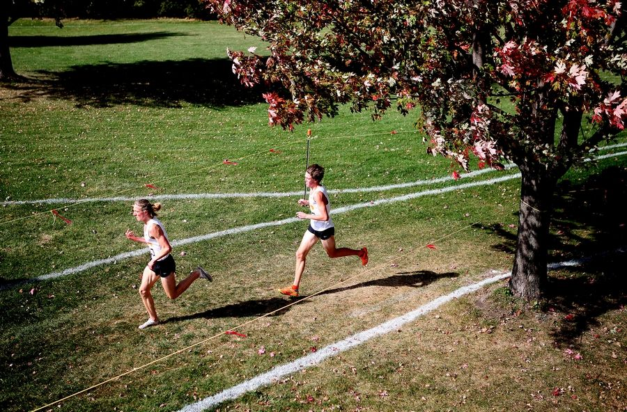 St. Charles East's Micah Wilson (left) and Luke Schildmeyer compete in the first of two races during the DuKane Conference boys cross country meet at Lake Park High School's East Campus on Oct. 17.