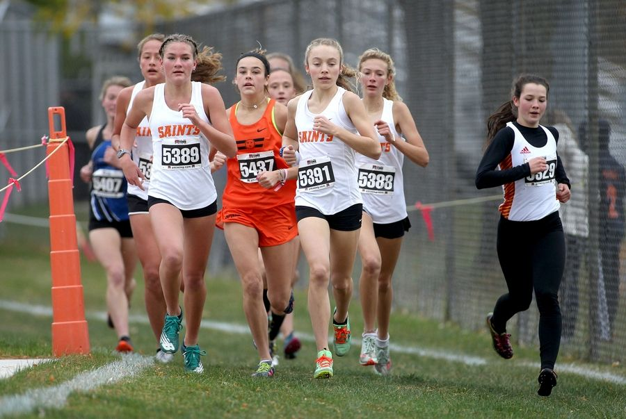 Runners compete in the first of two girls varsity races during the DuKane Conference cross country meet at Lake Park High School's East Campus on Oct. 17.