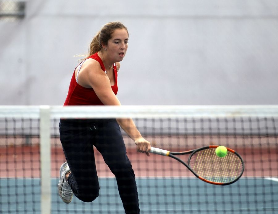 Batavia's Alex Klein reaches for the ball during a match against Naperville North's Julie Majcher during the Class 2A West Aurora sectional on Friday.