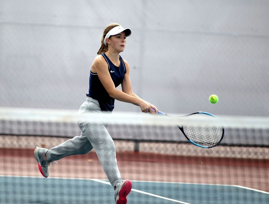 Naperville North's Julie Majcher returns the ball during a match against Batavia's Alex Klein during the 2A West Aurora Sectional Oct. 16 at West Aurora High School.