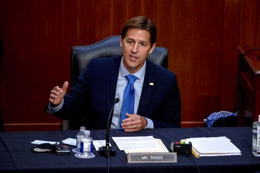 FILE - In this Oct. 14, 2020 file photo, Sen. Ben Sasse, R-Neb., speaks during the confirmation hearing for Supreme Court nominee Amy Coney Barrett, before the Senate Judiciary Committee on Capitol Hill in Washington. Sen. Sasse told constituents in a telephone town hall meeting that President Donald Trump has 'œflirted with white supremacists,'� mocks Christian evangelicals in private, and 'œkisses dictators' butts.'� (Hilary Swift/The New York Times via AP, Pool, File)