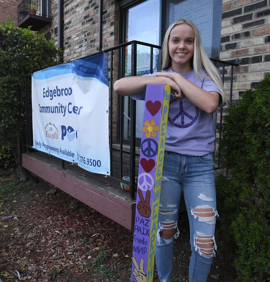 Courtney Murphy of Palatine with one of her many peace poles that she has posted around town.