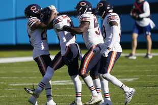 Teammates congratulate Chicago Bears defensive back DeAndre Houston-Carson (36), second from left, following Carson's interception against the Carolina Panthers during the second half of an NFL football game in Charlotte, N.C., Sunday, Oct. 18, 2020.