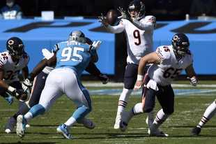 Chicago Bears quarterback Nick Foles (9) reaches for the ball during the first half of an NFL football game against the Carolina Panthers in Charlotte, N.C., Sunday, Oct. 18, 2020.