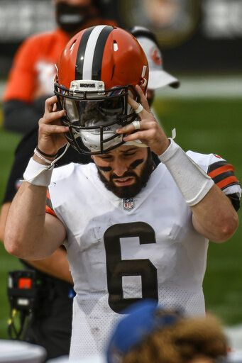 Cleveland Browns quarterback Baker Mayfield (6) pulls off his helmet on the sideline after being sacked by the Pittsburgh Steelers during the first half of an NFL football game, Sunday, Oct. 18, 2020, in Pittsburgh.