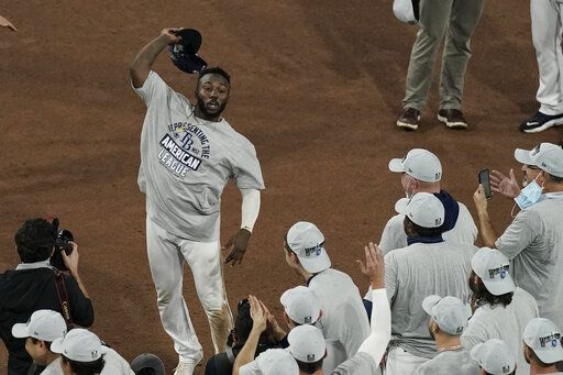 Tampa Bay Rays left fielder Randy Arozarena celebrates his MVP award following their victory against the Houston Astros in Game 7 of a baseball American League Championship Series, Saturday, Oct. 17, 2020, in San Diego. The Rays defeated the Astros 4-2 to win the series 4-3 games.