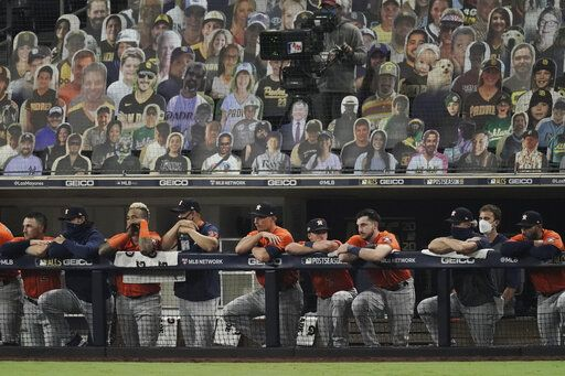 Houston Astros watch the eighth inning in Game 7 of a baseball American League Championship Series against the Tampa Bay Rays, Saturday, Oct. 17, 2020, in San Diego.