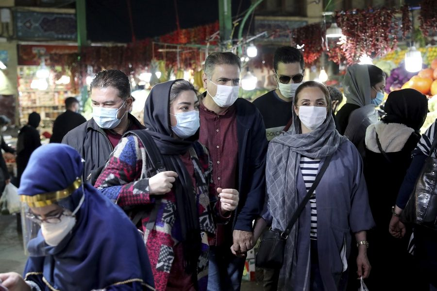 People wear protective face masks to help prevent the spread of the coronavirus, in the Tajrish traditional bazaar in northern Tehran, Iran. On Monday, Iran recorded its worst day of new deaths since the start of the coronavirus pandemic, with 337 confirmed dead.