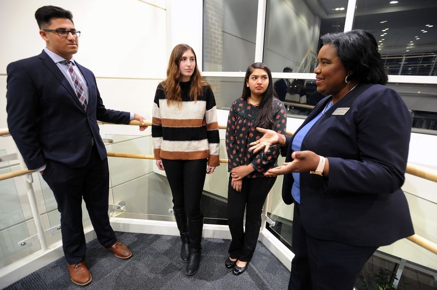 Harper College President Avis Proctor, right, chats with, from left, Arij Ahmed, Madelyn Kuffel and Meha Patel last December during an event honoring Promise Scholarship program donors. Those students were among 421 in the first cohort of the school's tuition-free program.