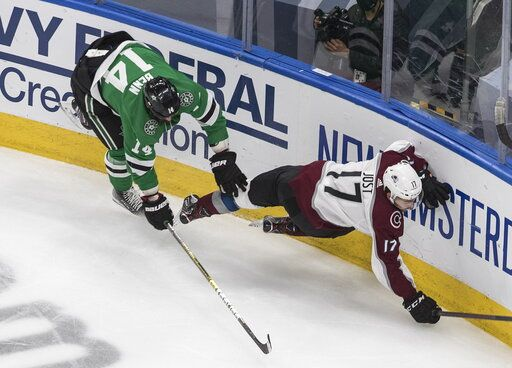 Dallas Stars left wing Jamie Benn (14) checks Colorado Avalanche center Tyson Jost (17) during the third period of Game 6 of an NHL hockey second-round playoff series, Wednesday, Sept. 2, 2020, in Edmonton, Alberta. (Jason Franson/The Canadian Press via AP)