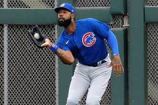 Chicago Cubs' Jason Heyward fields a fly out hit by San Francisco Giants' Brandon Belt during the second inning of a spring training baseball game Tuesday, March 10, 2020, in Scottsdale, Ariz. (AP Photo/Matt York)